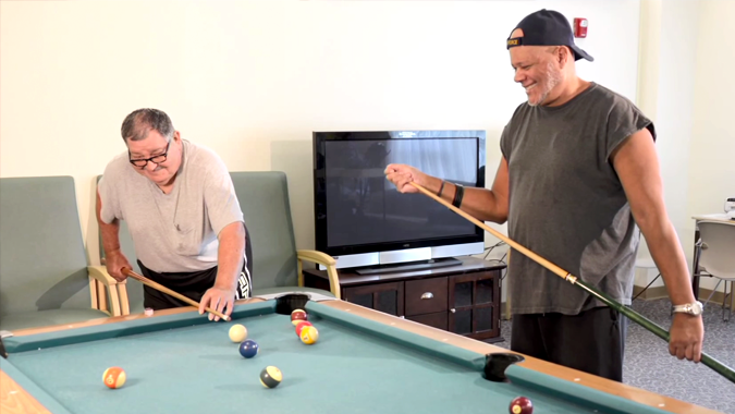 Two veterans play pool at a PA veterans home